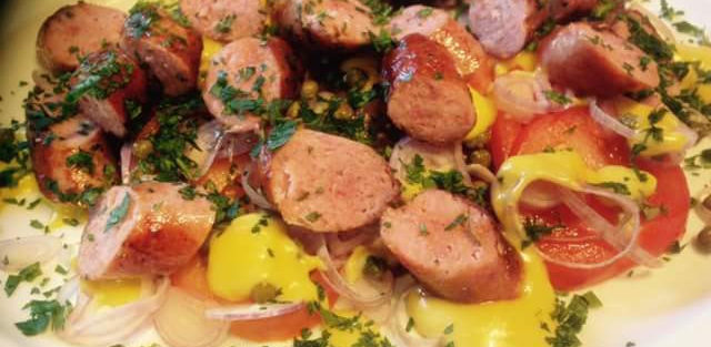 Hot Toulouse Sausage with a tomato, caper, and shallot salad